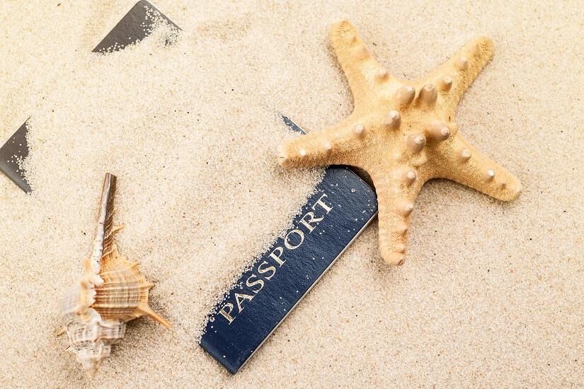 Bild Reisepass im Sand